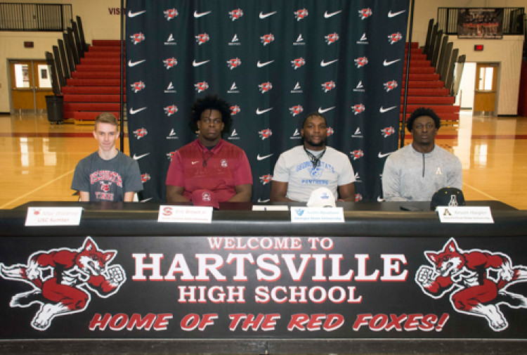 Four HHS student-athletes sign letters of intent